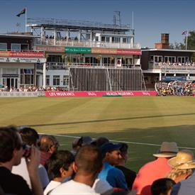 Crowd watching cricket match