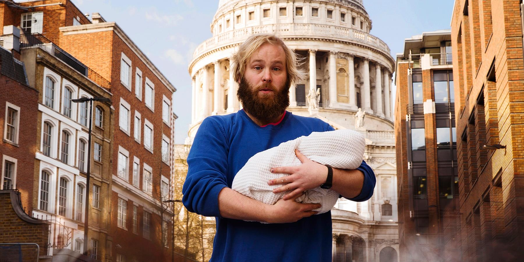 man holding baby in london