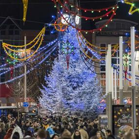 christmas light switch on near clock tower