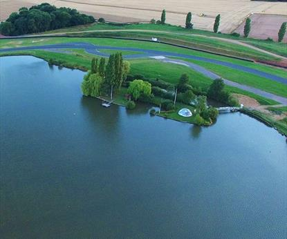Racing track around a lake in the countryside.